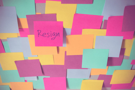 Resign sticky note on the center of many color note
