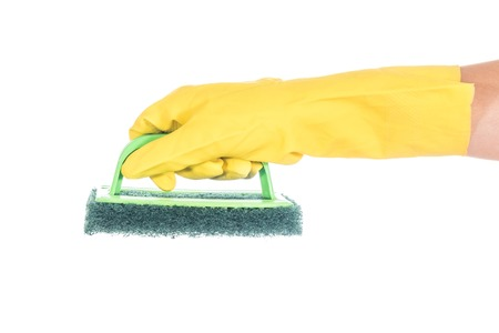 Hand in yellow glove holding a sponge for dishwashing  isolated on white background