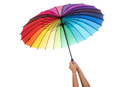 Female hand holding colorful umbrella isolated on white background