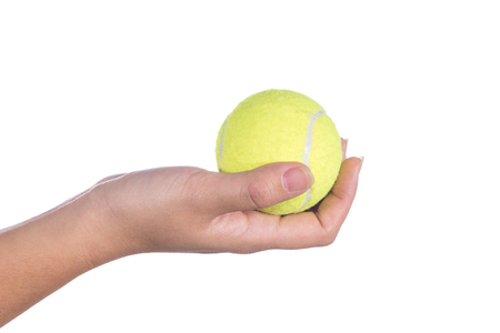 women hand holding tennis ball isolated on white background