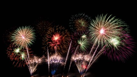 abstract beautiful firework celebration rows on black background Stock Photo