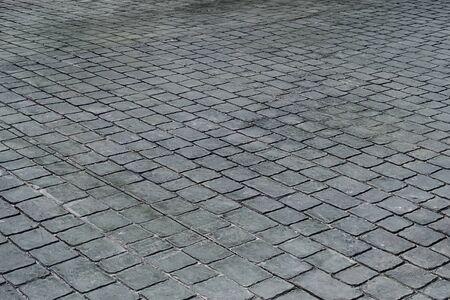 black stone tiles floor on road or walkway