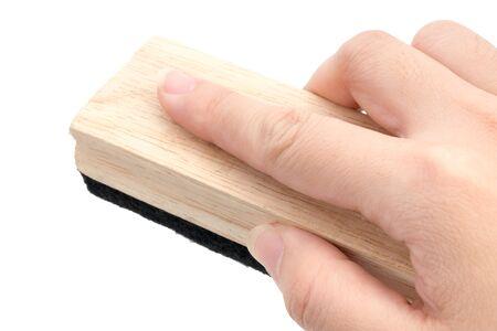 Close Up Hand holding brush erase isolated on white background