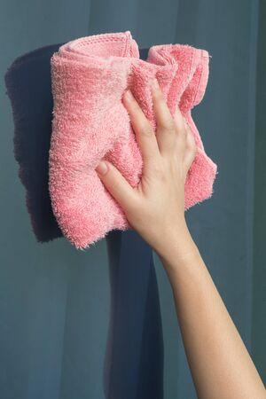 Women hand cleaning glass window.