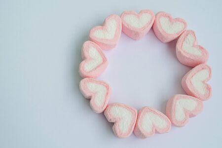 Heart shape marshmallow on white background.