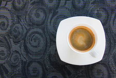 Top view shot of espresso coffee cup on the table