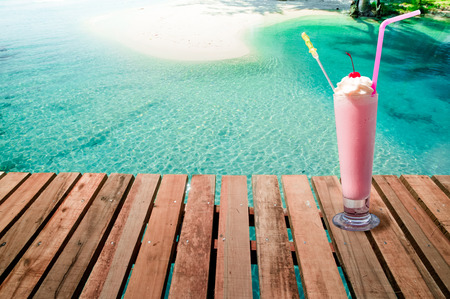 Strawberry milkshake by beach side  for Summer vacation. Imagens - 79627893