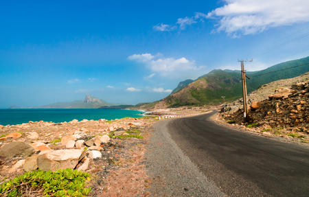Road along the turquoise sea white sand and rocky under sunshine very beautiful nature at Bai nhat beach Condao island - Vietnam. Stock fotó