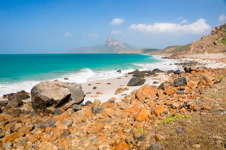 jail: turquoise sea white sand and rocky under sunshine very beautiful nature at Bai nhat beach Condao island - Vietnam. Stock Photo