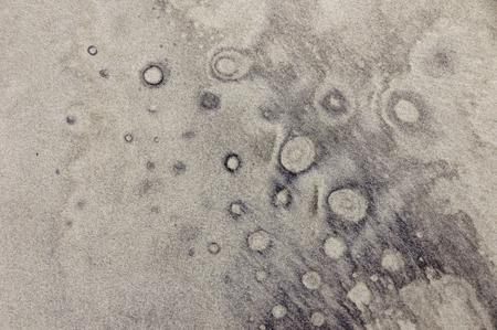 Nature drawing bubble like pattern on sand beach background