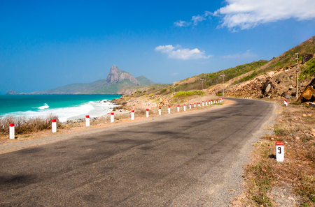 Road along the turquoise sea white sand and rocky under sunshine very beautiful nature at Bai nhat beach Condao island - Vietnam. Imagens - 79972937