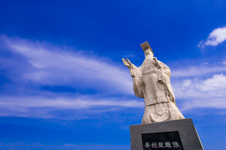 Modern statue of emperor Qin Shi Huang at the Terracotta Army entrance  gate of  Qin Shi Huang tomb in Xian , China
