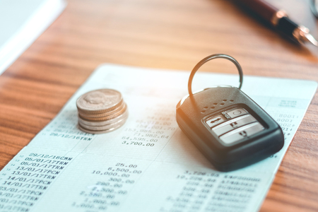 Car insurance,Car remote and account book in finance and banking concept Stock Photo
