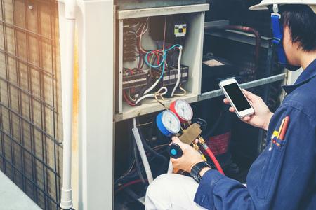 Technician is checking air conditioner Archivio Fotografico