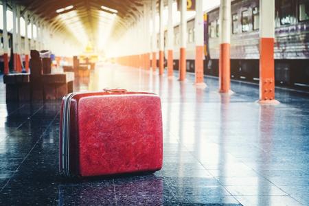 Bag and trip at train station Фото со стока