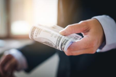Business man holding dollar bills Stock Photo