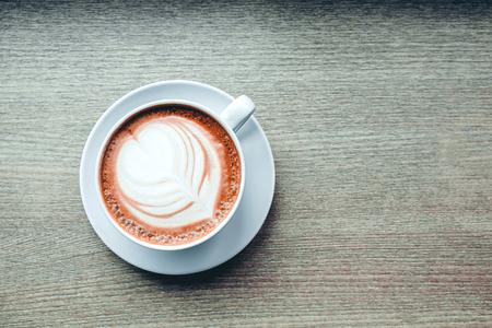 Coffee cup on wood vintage tone