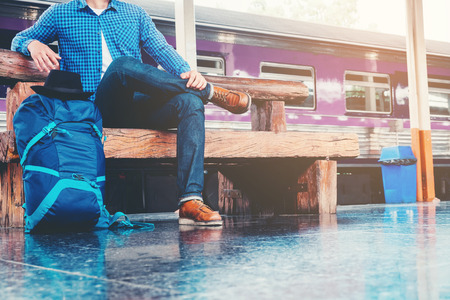 Tourist backpacker wait to travel at train station