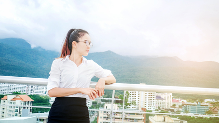 Business woman on urban scene looking view and thinking success