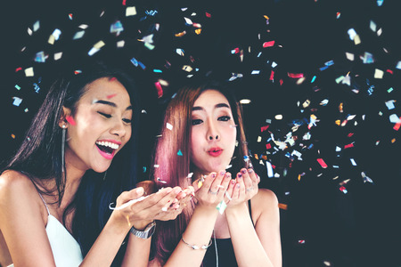 celebration party group of asian young woman and confetti happy,funny concept