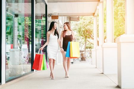 Happy women friendship Enjoying Spending shopping bags in Fashion shopping street Stock Photo
