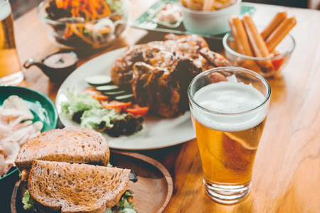 Beer Party and grilled chicken happy enjoying in home Stock Photo