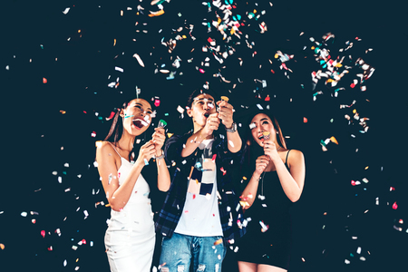 celebration party group of asian young people holding confetti happy and funny concept Stock Photo