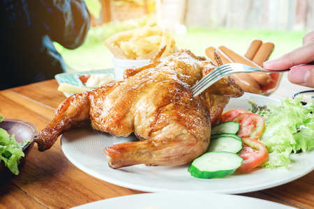 People Party and eating grilled chicken are happy enjoying in home