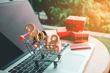 Shopping onlineWooden sticks 2018 with credit card concept Stock Photo