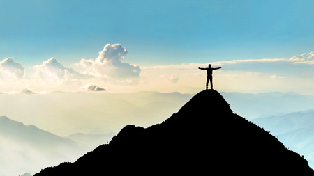 Businessman success raising arms stand on top of hill