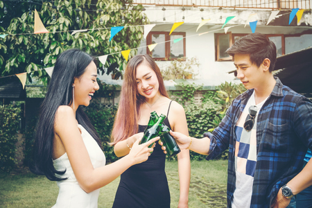 Group of young asian people happy while enjoying home party on garden home