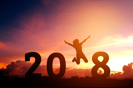 Silhouette young woman jumping to 2018 new year Stockfoto