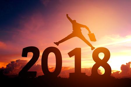 실루엣 젊은 비즈니스 맨 행복 한 2018 년 새 해 스톡 콘텐츠