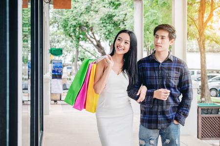 Asian Couple Enjoying Romance Spending shopping bags Fashion shopping street