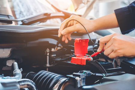 Hands check battery car mechanic working in auto repair service 스톡 콘텐츠