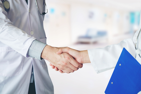 Two Doctor is talking and handshake in the hospital. Stock Photo