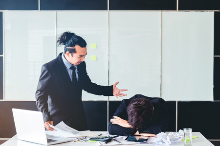 Asian Bad angry boss yelling at business man sad depressed employee reprimand from team leader missed deadline concept