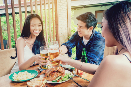 Group friend young asian people celebrating beer festivals happy while enjoying home party