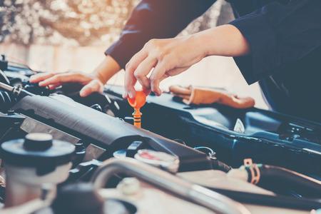 Car Engine oil mechanic working in auto repair service