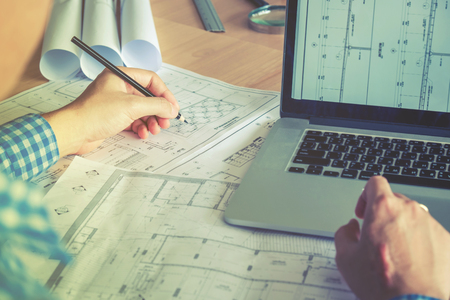 Architect or engineer working in office on blueprint. Architects workplace Stockfoto