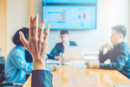 Business women raised hand business seminar , business meeting concept