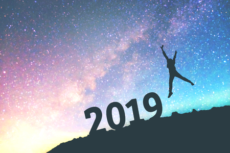 Silhouette young man Happy for 2019 new year background on  the Milky Way galaxy Stock Photo