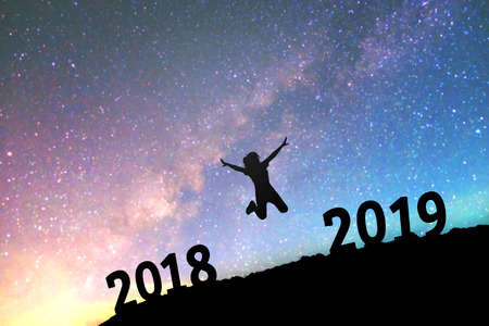 Silhouette young woman Happy for 2019 new year background on  the Milky Way galaxy Banco de Imagens