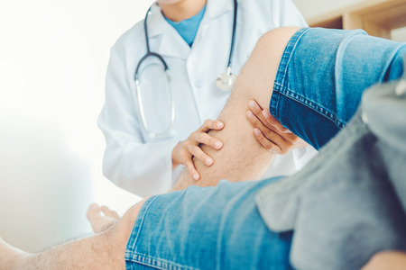 Doctor consulting with patient Knee problems Physical therapy concept