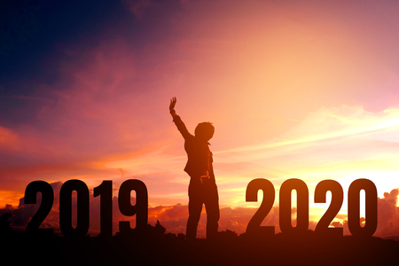 Silhouette young man happy to 2020 new year