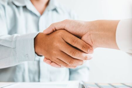Business people colleagues shaking hands during a meeting to sign agreement for New Partner Planning Strategy Analysis Concept