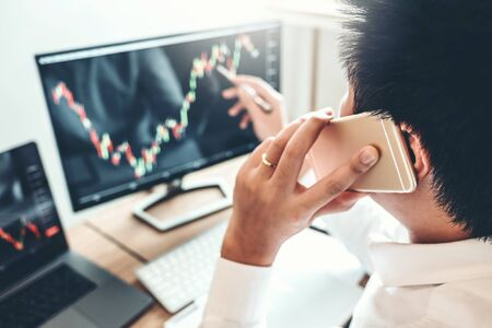 Investment stock market Entrepreneur Business Man using Phone discussing and analysis finance market graph stock market trading,stock chart concept