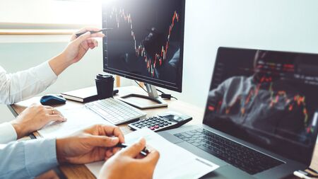 Business Team Investment Entrepreneur Trading discussing and analysis finance market graph stock market trading,stock chart concept