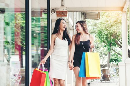 Happy Asian women friendship Enjoying Spending shopping bags in Fashion shopping street Stock fotó