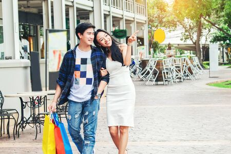 Couple Enjoying Romance Spending shopping bags Fashion shopping street